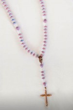 Paper Bead Rosary: Nicaraguan women created this 5 decade rosary using hand-painted, recycled wallpaper that has been cut and rolled into beautiful beads. The paper beads have been sealed in many coats of glossy water-based varnish.</p></p>Since each bead is handmade, product may vary slightly from picture shown here.