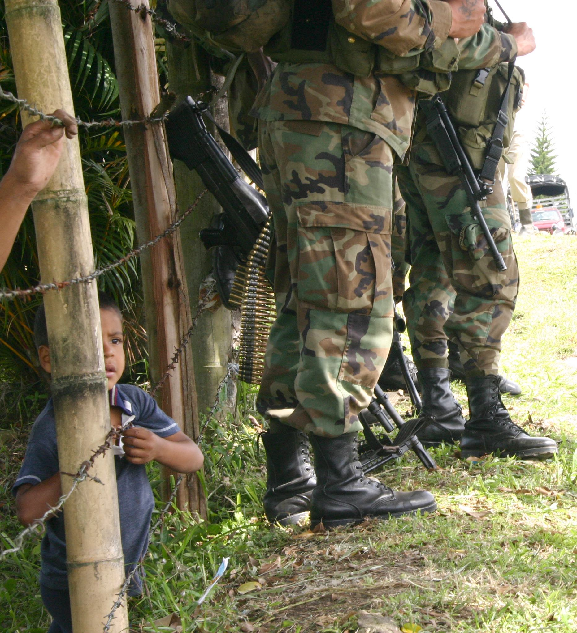 Colombian child and soldiers